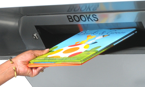 Book being deposited with one hand