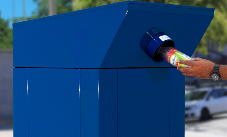 Beverage container being deposited into recycling container